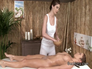 Sexy brunette gets oil massage