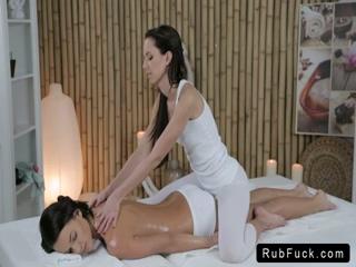 Masseuse massages hot brunette babe