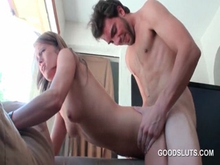 Slutty blonde banged from behind at orgy