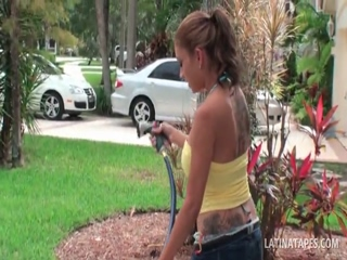 Busty latina siren washing the car in her swim suit 3