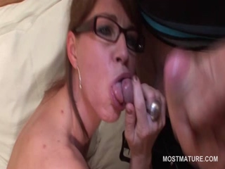 Arousing mature jizz shot on her sexy boobs