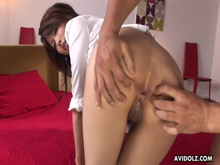Cute Asian babe rubbing her pussy then getting fingered