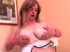 Mature Plays On Her Bed