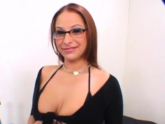 Redheaded Vixen Plays With A Huge Cock