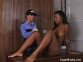 White police with black prisoner girl.